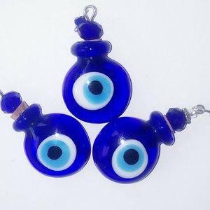 Evil eye bottle essential oils fragrance or ashes